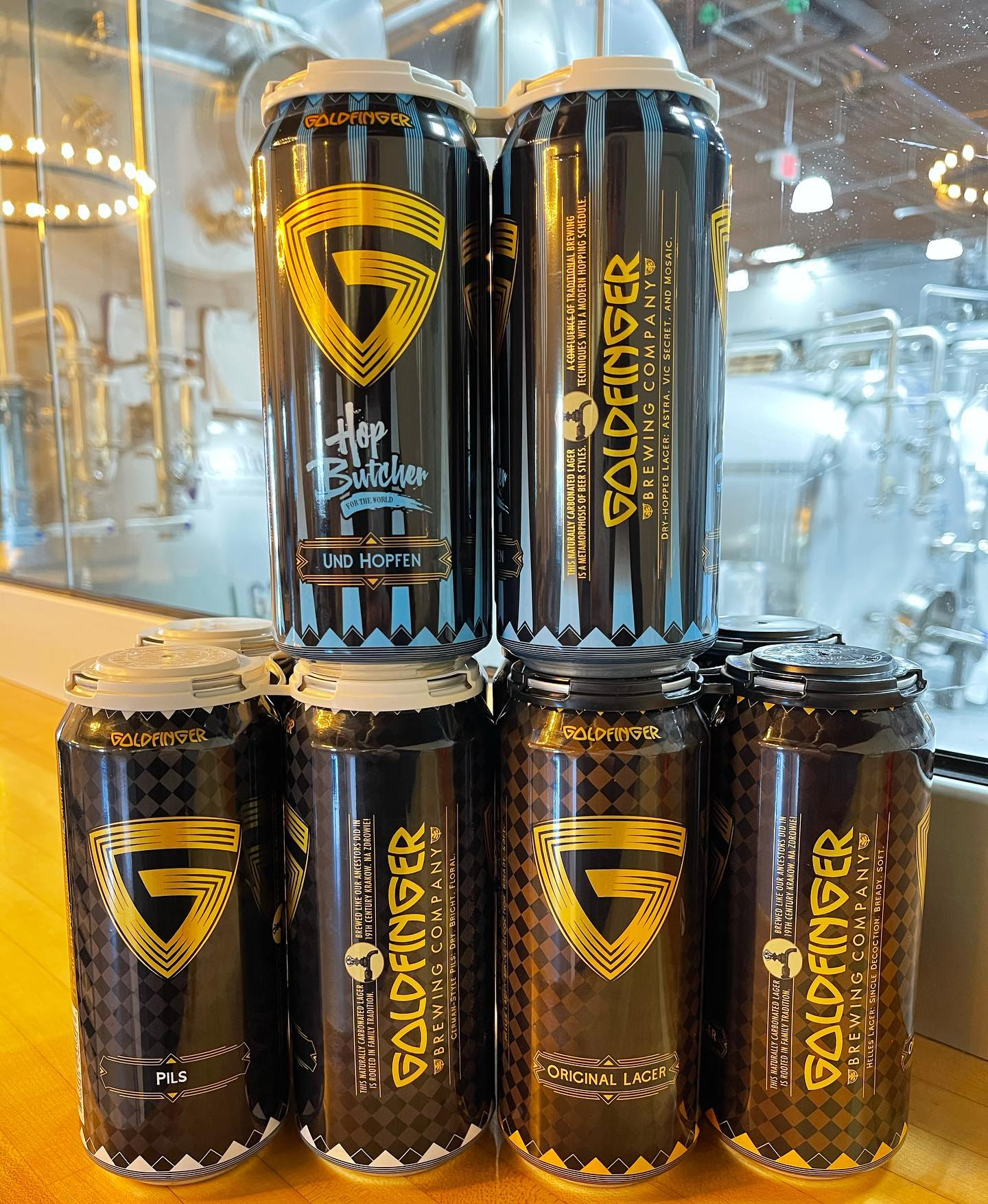 Goldfinger Brewing's three different type of cans, including their collab with Hop Butcher