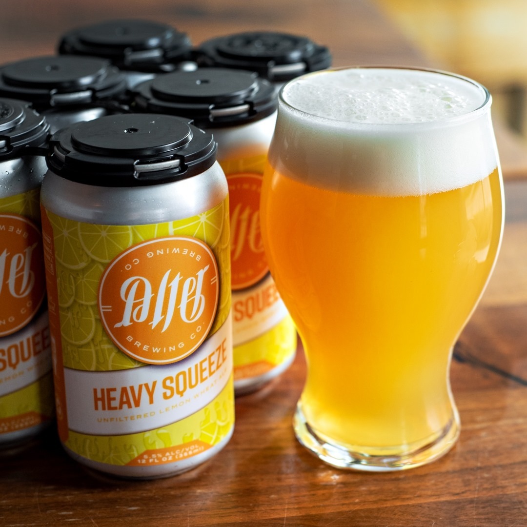 6 cans and one full glass of Heavy Squeeze from Alter Brewing Company