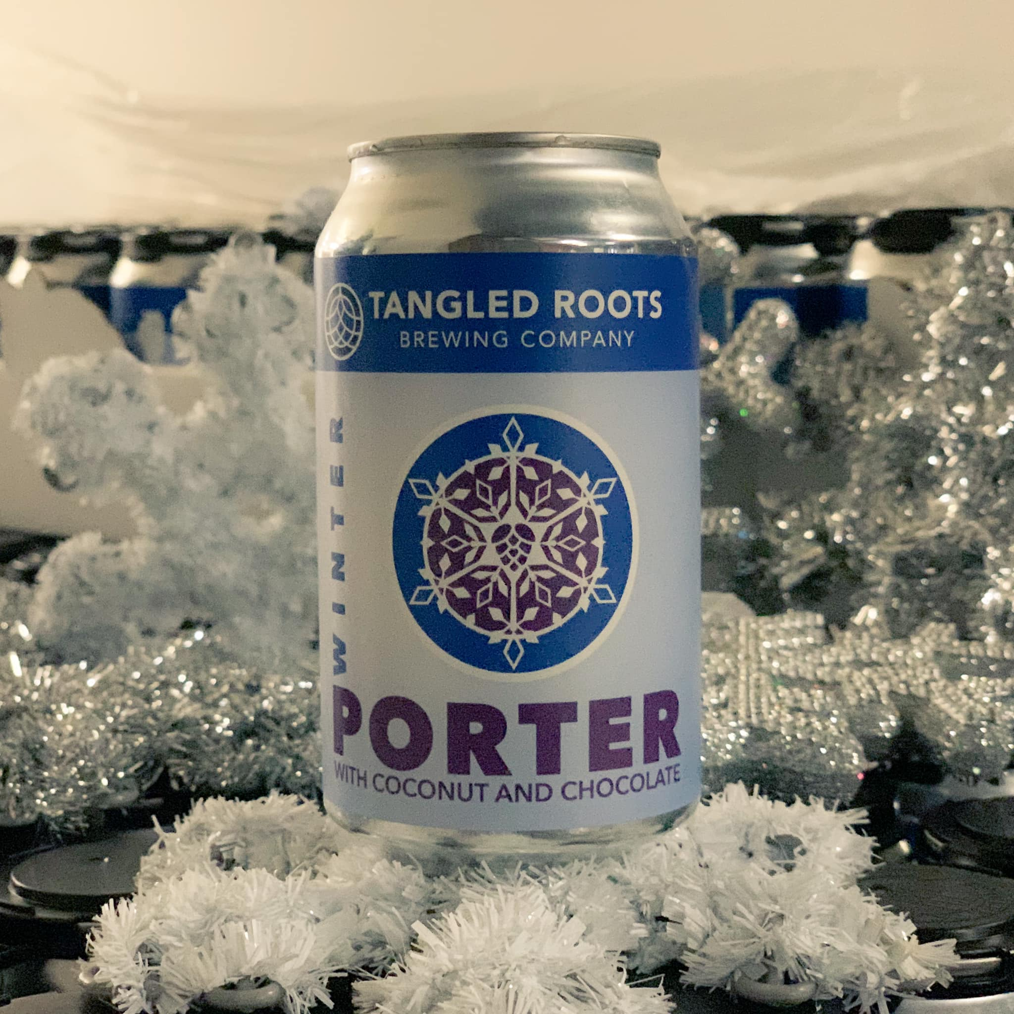 Can of Winter Porter from Tangled Roots, surrounded by snowflake decorations