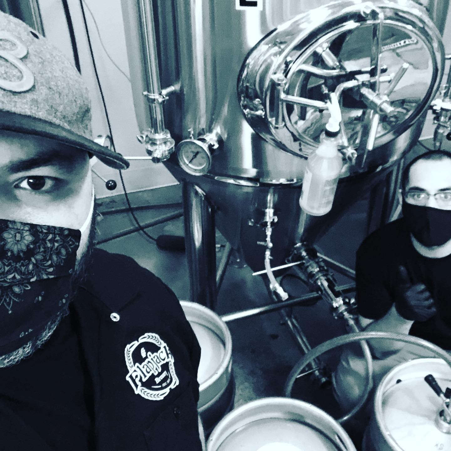 Brewers working on a beer at Flapjack Brewery