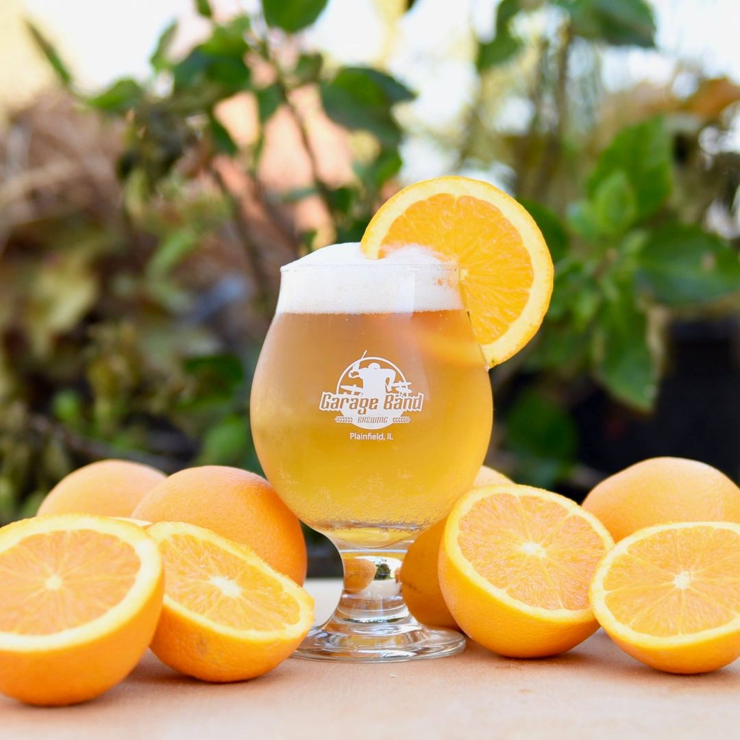 Orange Dizzy Up The Girl from Garage Band Brewing (surrounded by oranges)