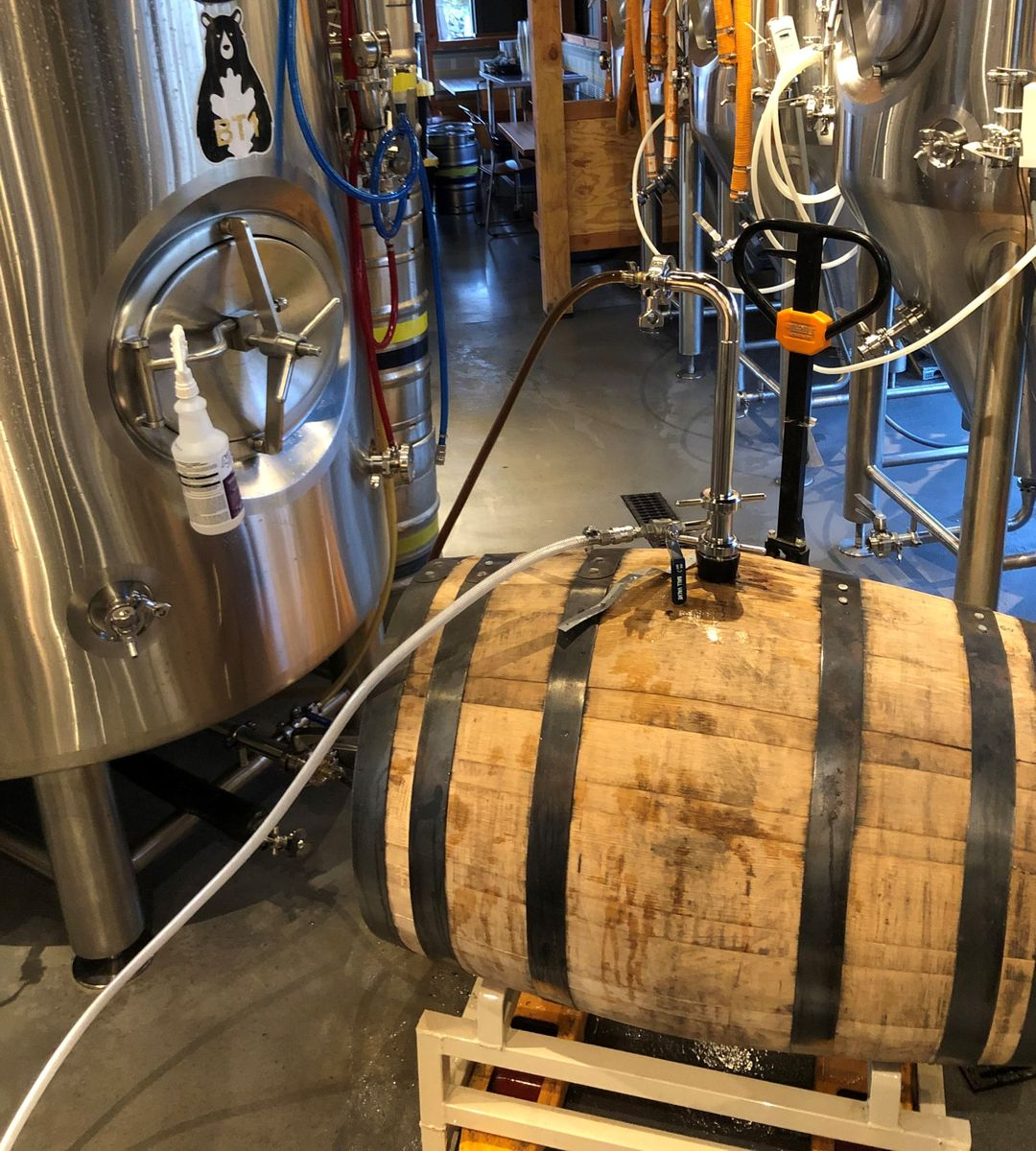 Stout being transferred from barrel to tank at Ike & Oak
