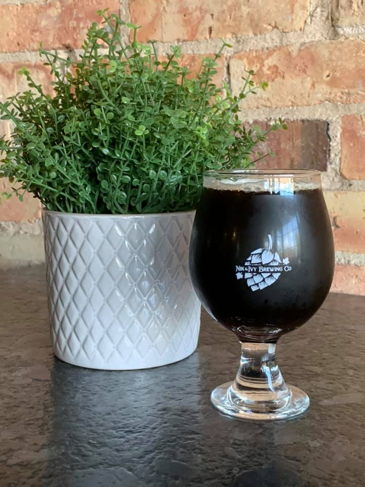 Porter in a glass, next to a fake small plant