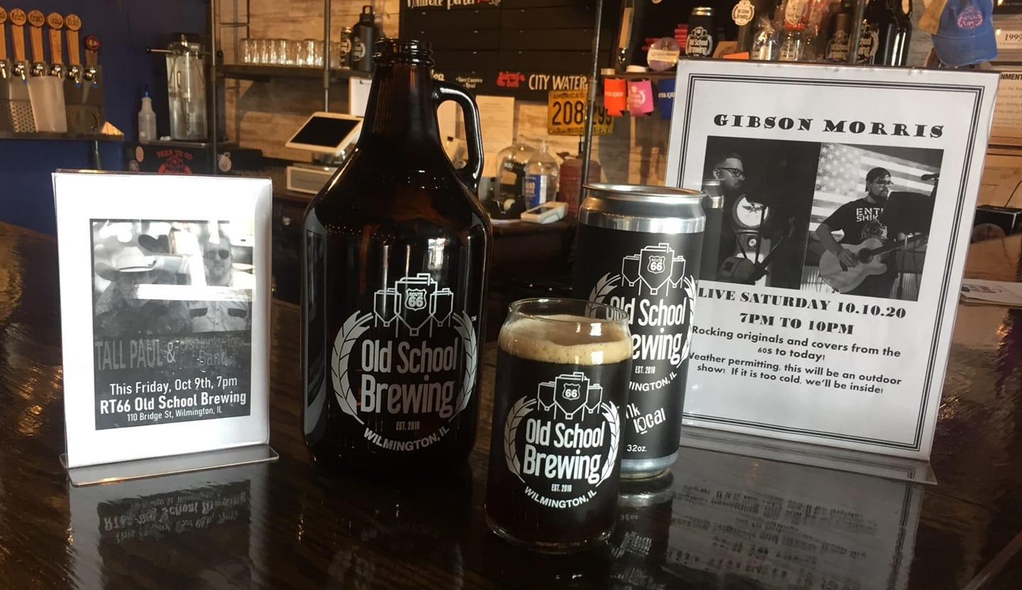 Glass of Millrace Porter from Rt66 Old School Brewing, surrounded by a crowler and growler