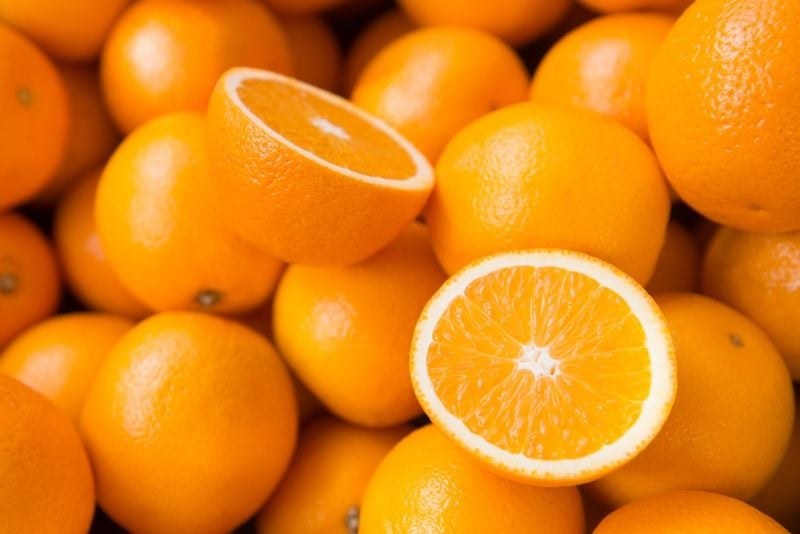 Several oranges in a pile