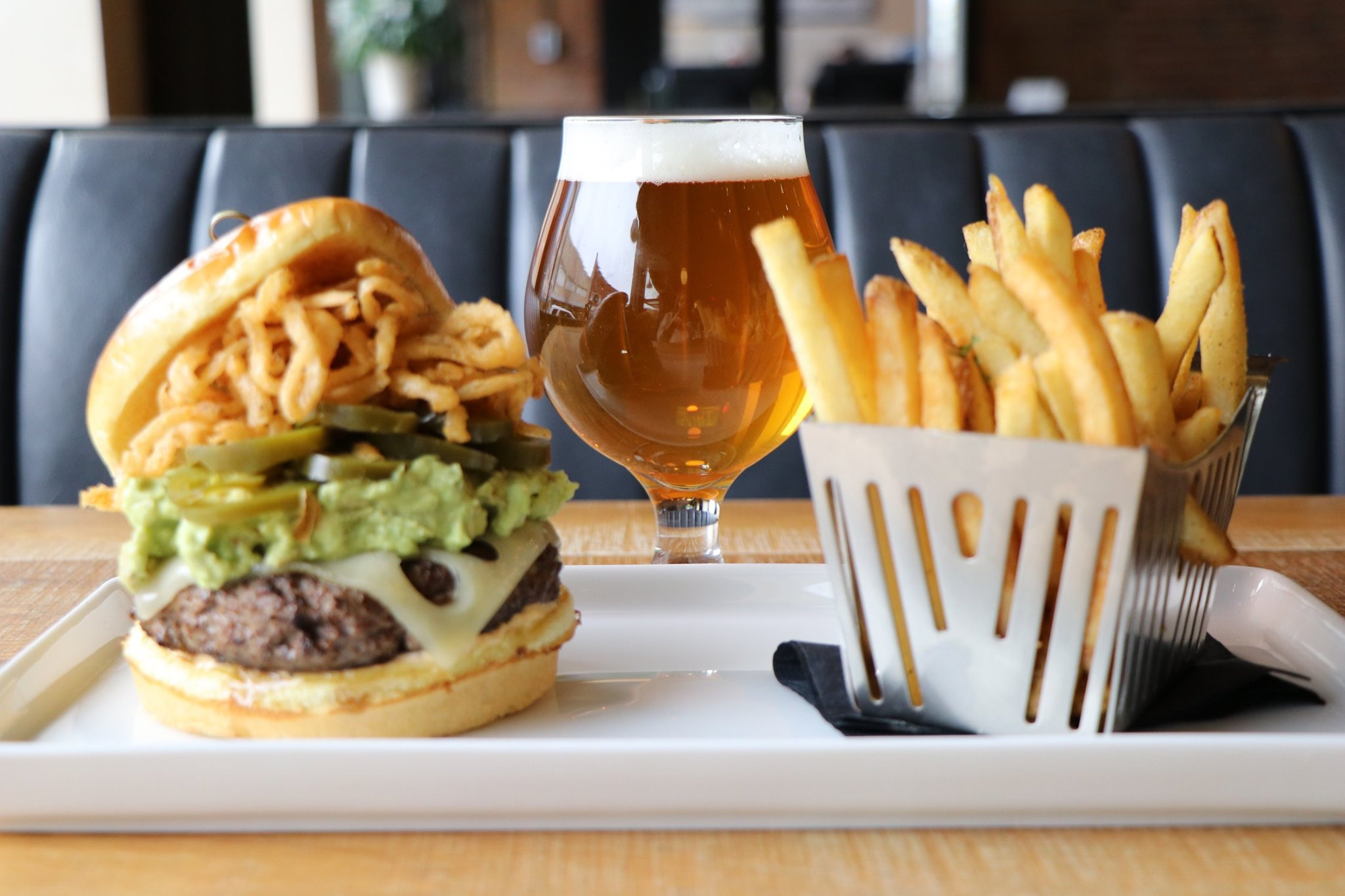 Lone Buffalo burger with a side or fries and a beer.
