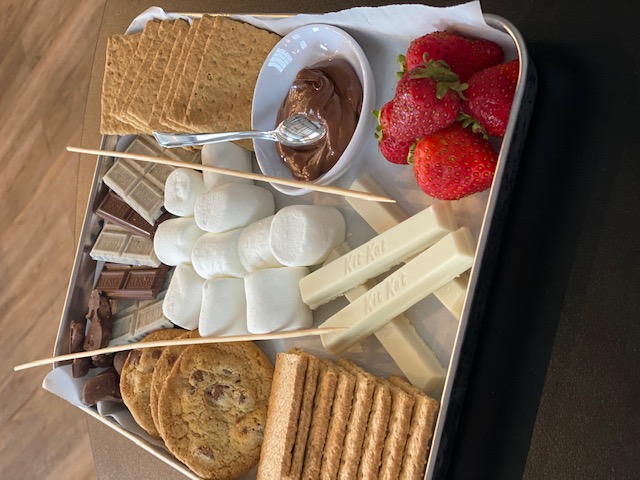 A tray filled with dessert treats and chocolate fondu to dip