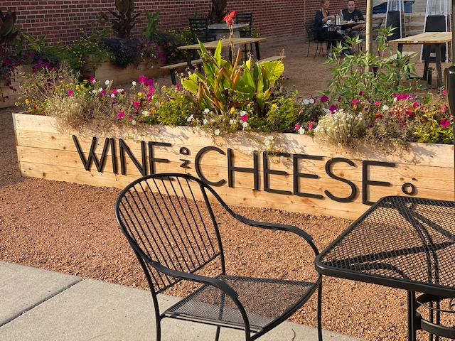 The Wine & Cheese outdoor patio sign