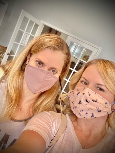Nelie posing with her friend with mask on