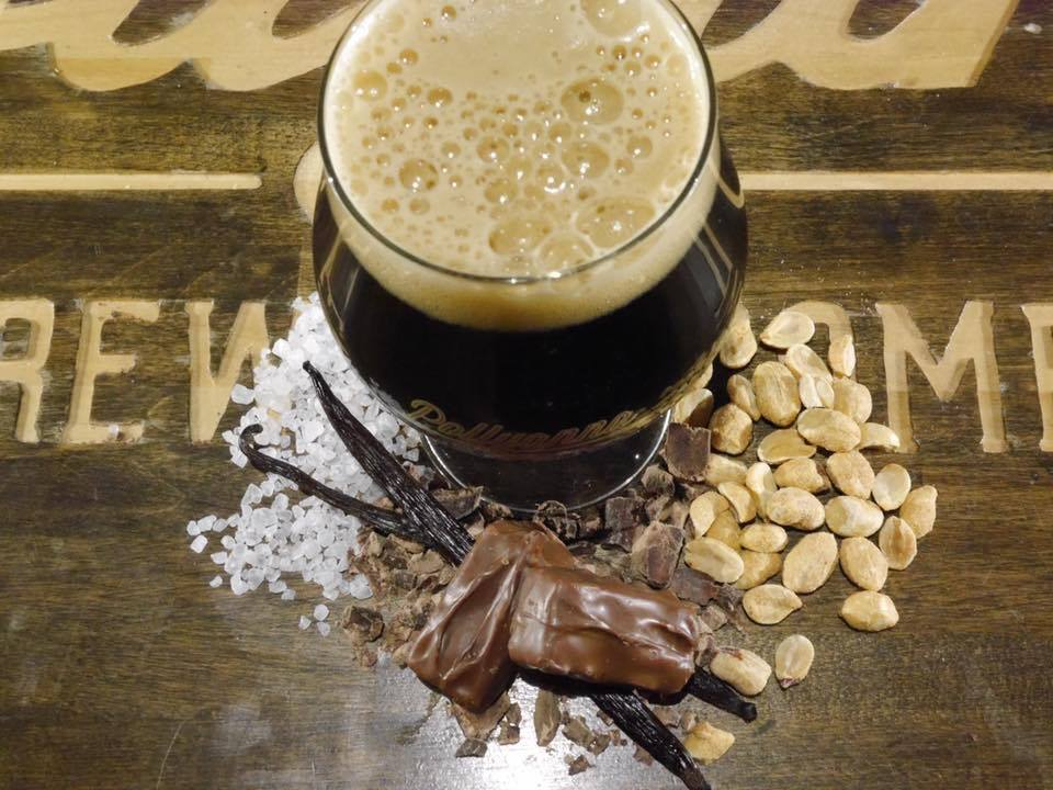 Pollyanna's fun size beer, surrounded by vanilla, peanuts, sugar, chocolate and more.