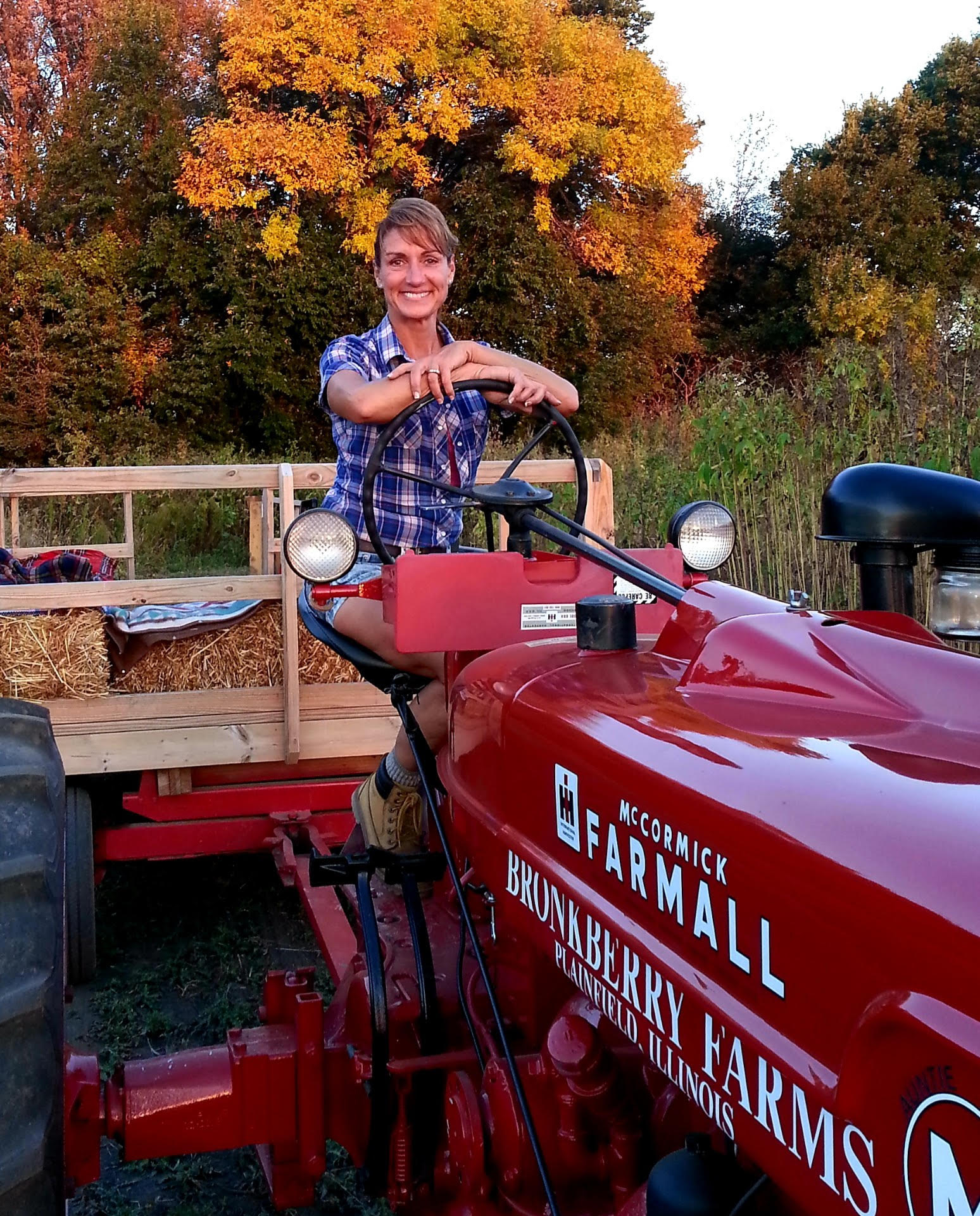 Jennifer Bronk sitting on top of a tractor