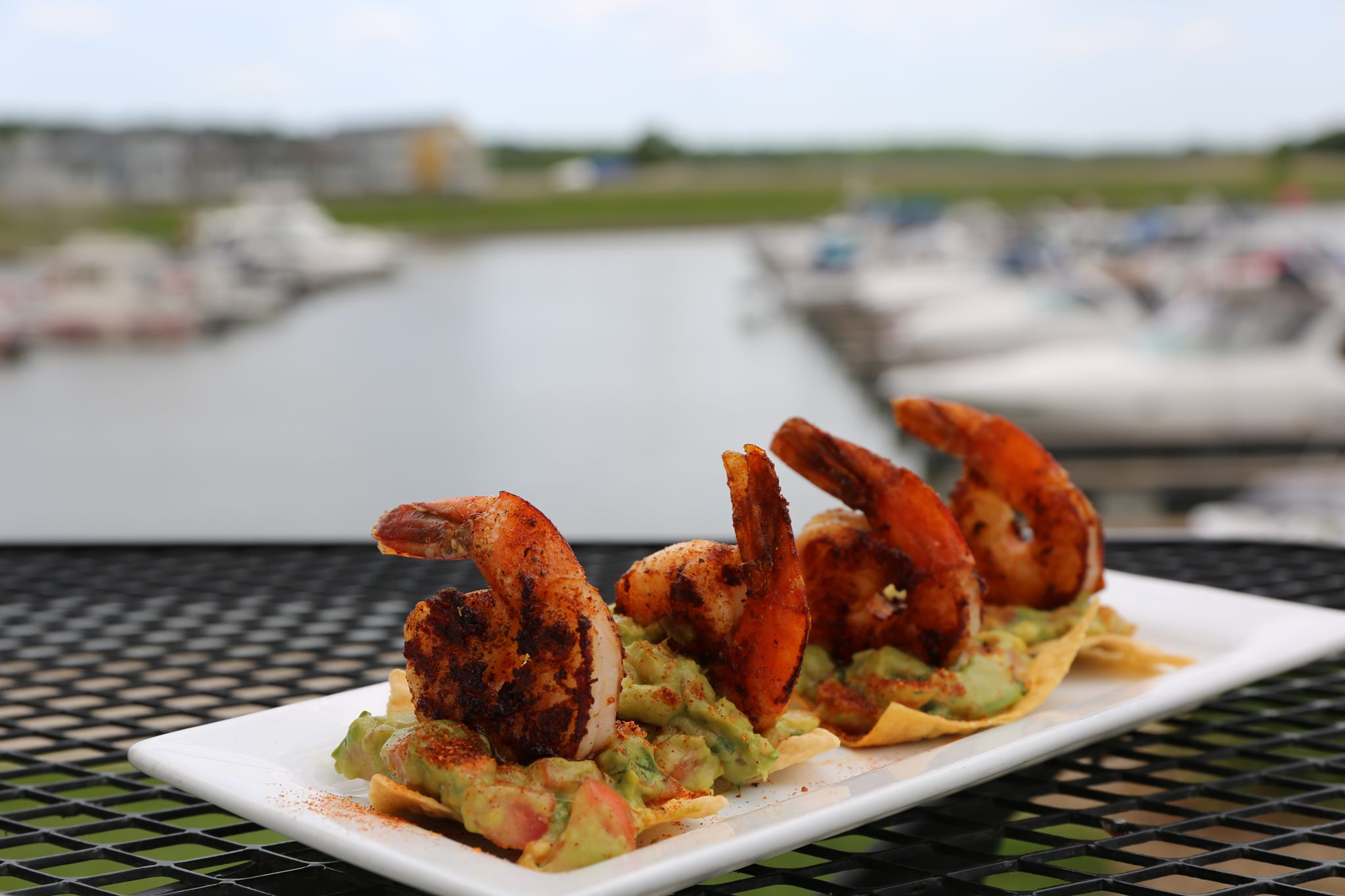 shrimp nachos by the water