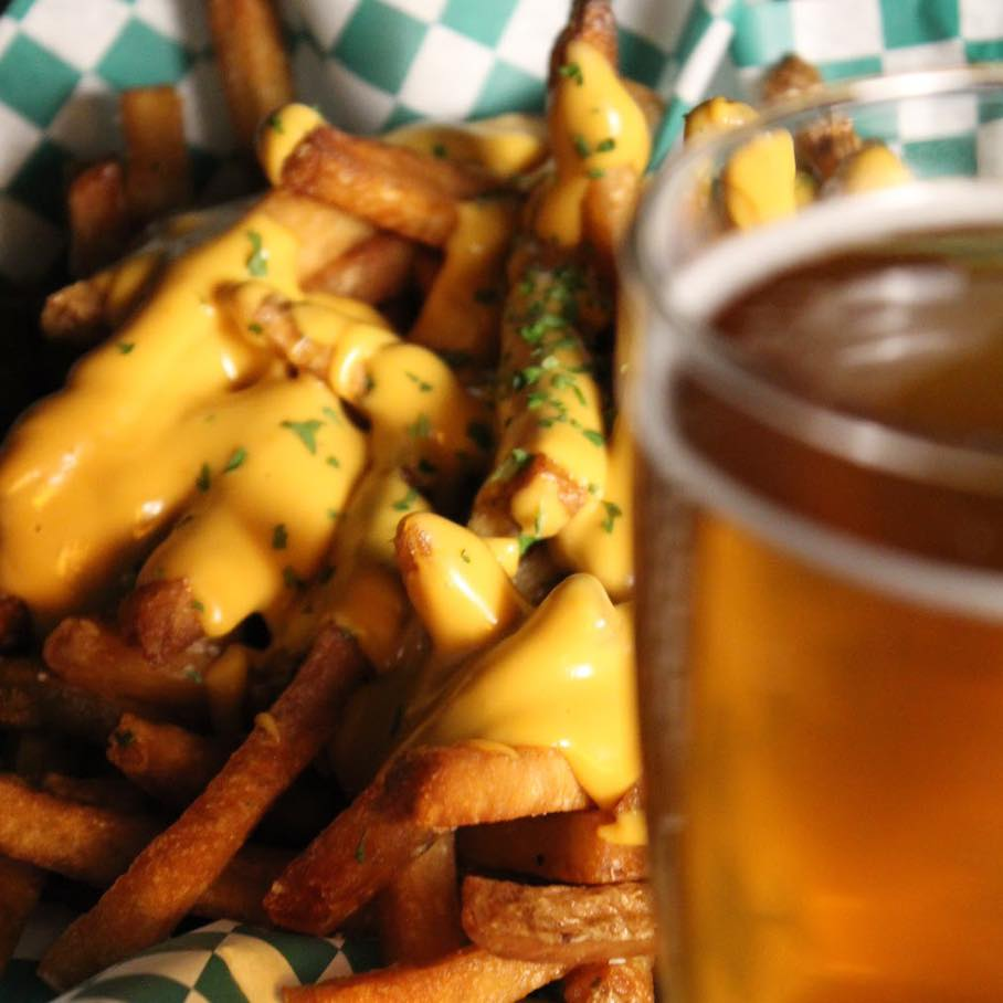 migraine brewing cheese fries with a beer