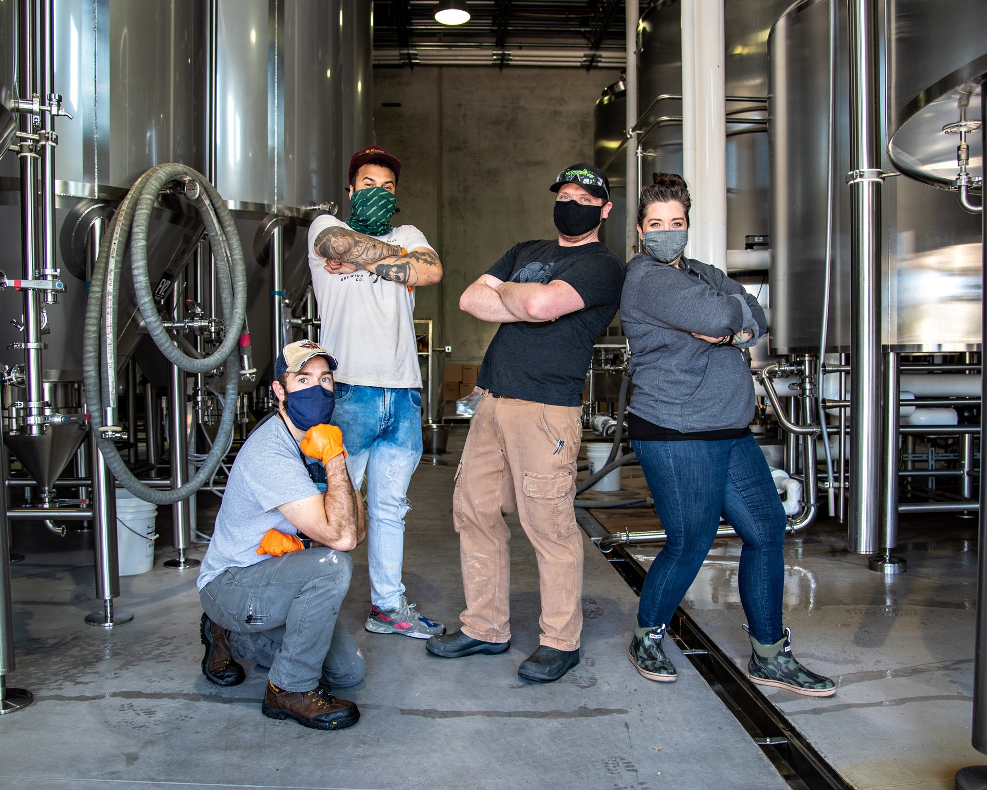 Brewers posing for photo after brewing
