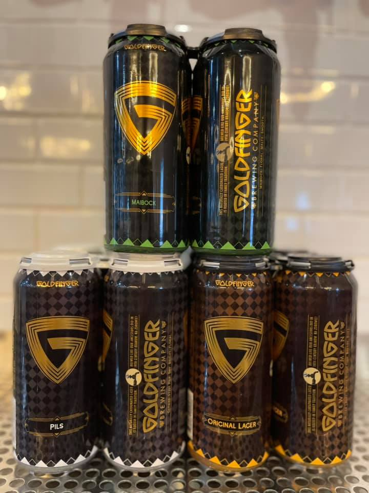 Six cans of Goldfinger Brewing Company's Maibock