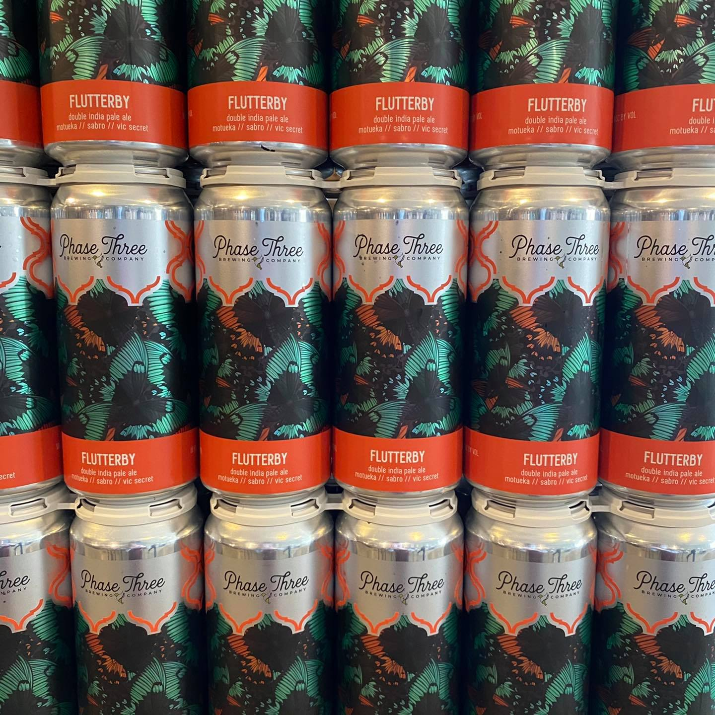 Stacks of cans from Phase Three Brewing