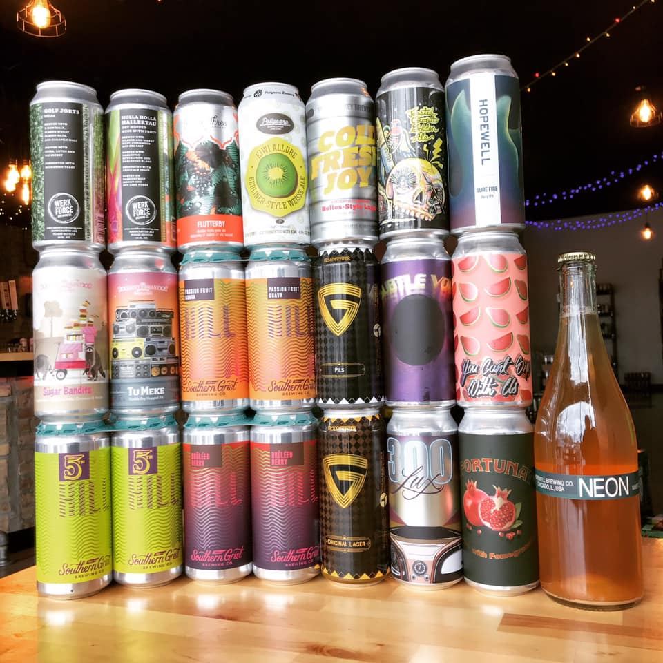 many cans and bottles from Orange & Brew