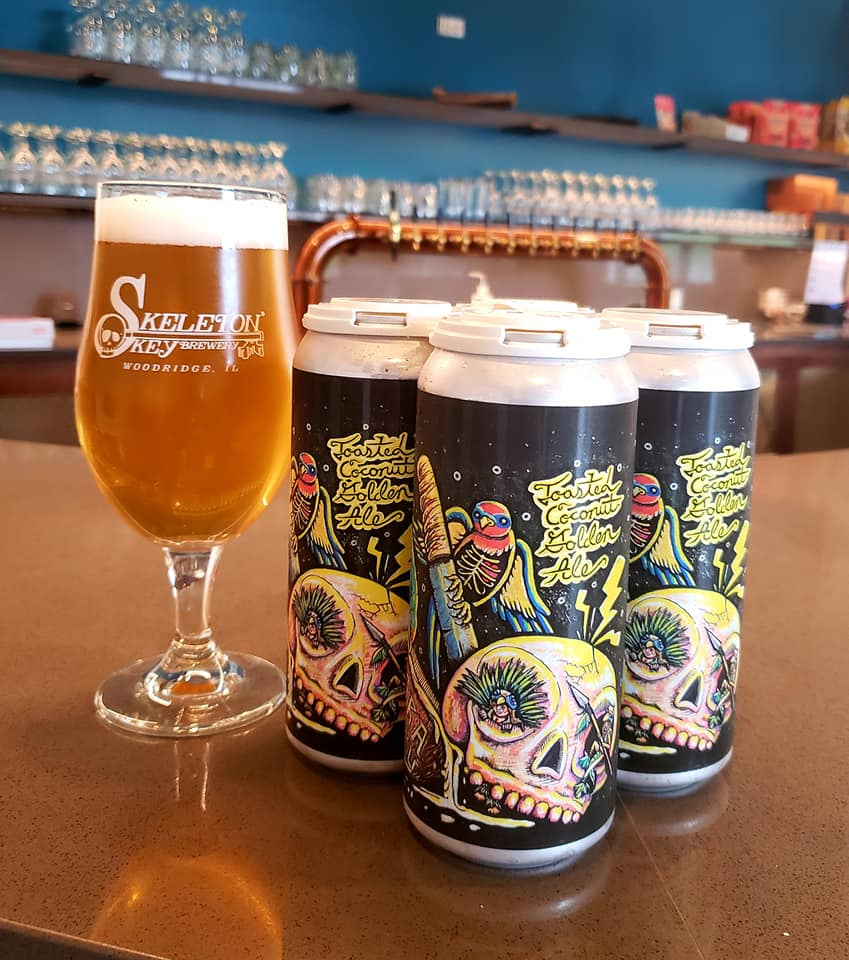 A glass and four pack of Migratory from Skeleton Key Brewery