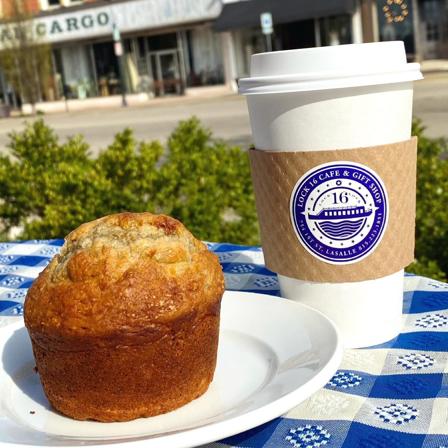 a muffin and a cup of coffee