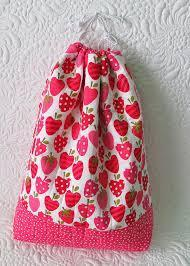 small draw string bag made with strawberry and apple patterned cloth