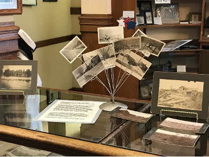 old photos of mendota's history on display inside of the Mendota museum