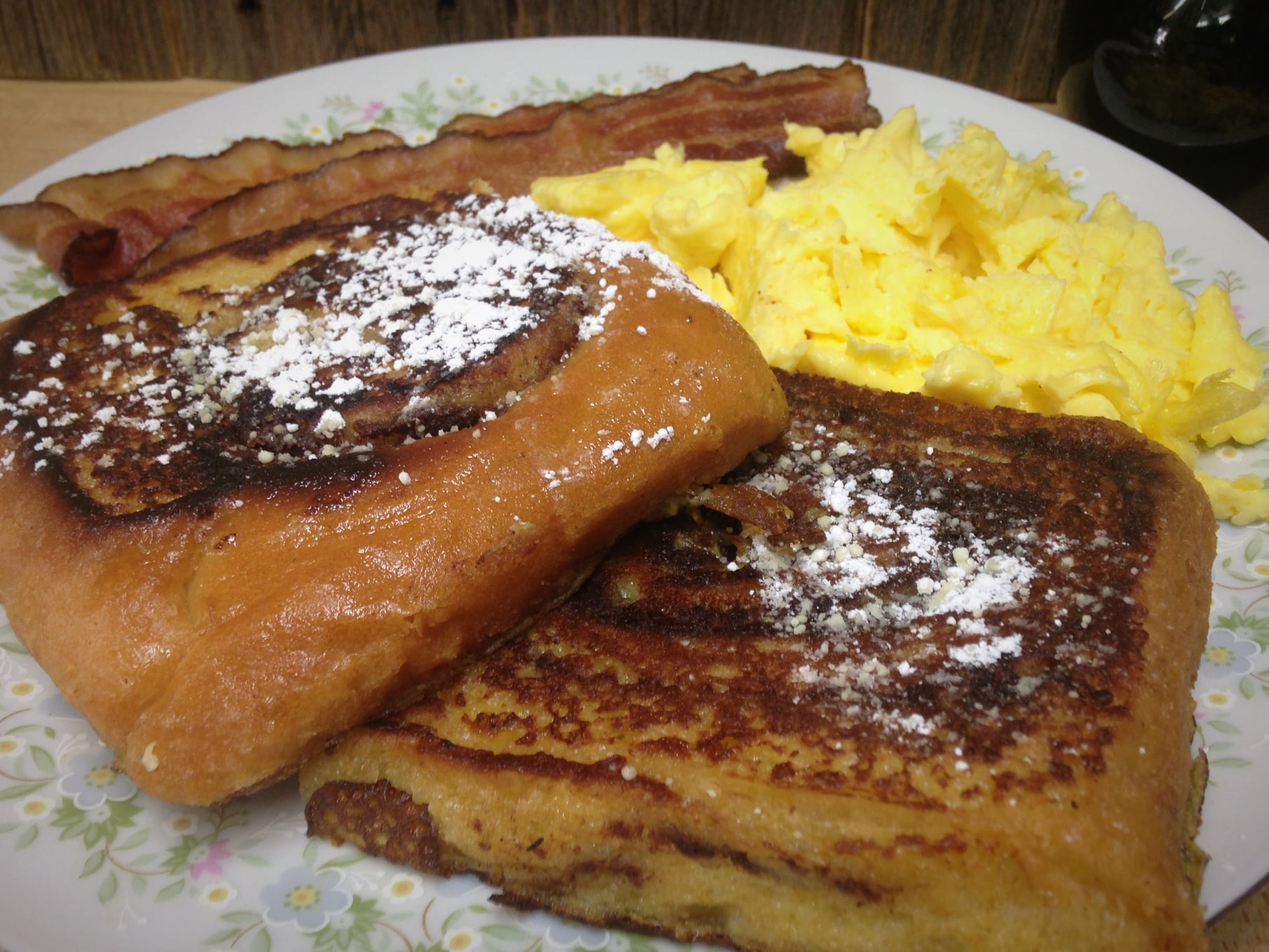 French toast, bacon and scramble eggs on a plate