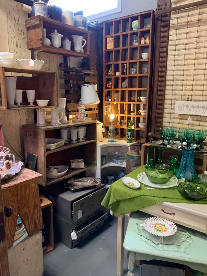 antiques like plates and cups on display inside of true north