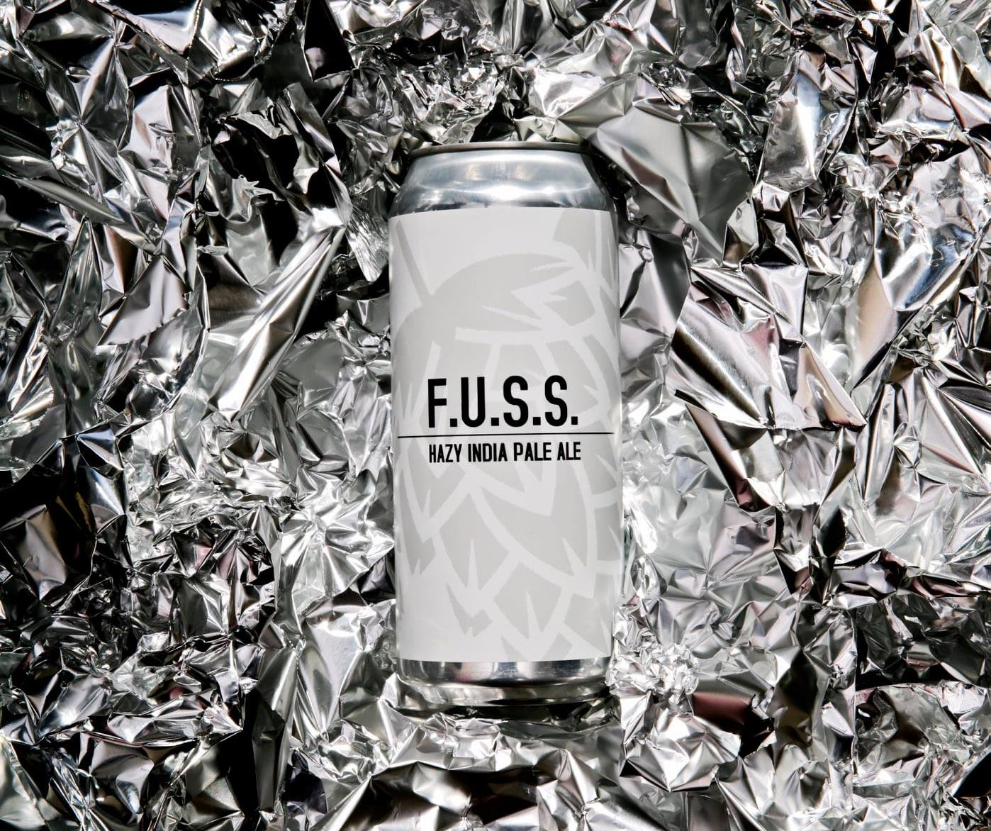 Can of Fuss, with a background of crinkled tin foil