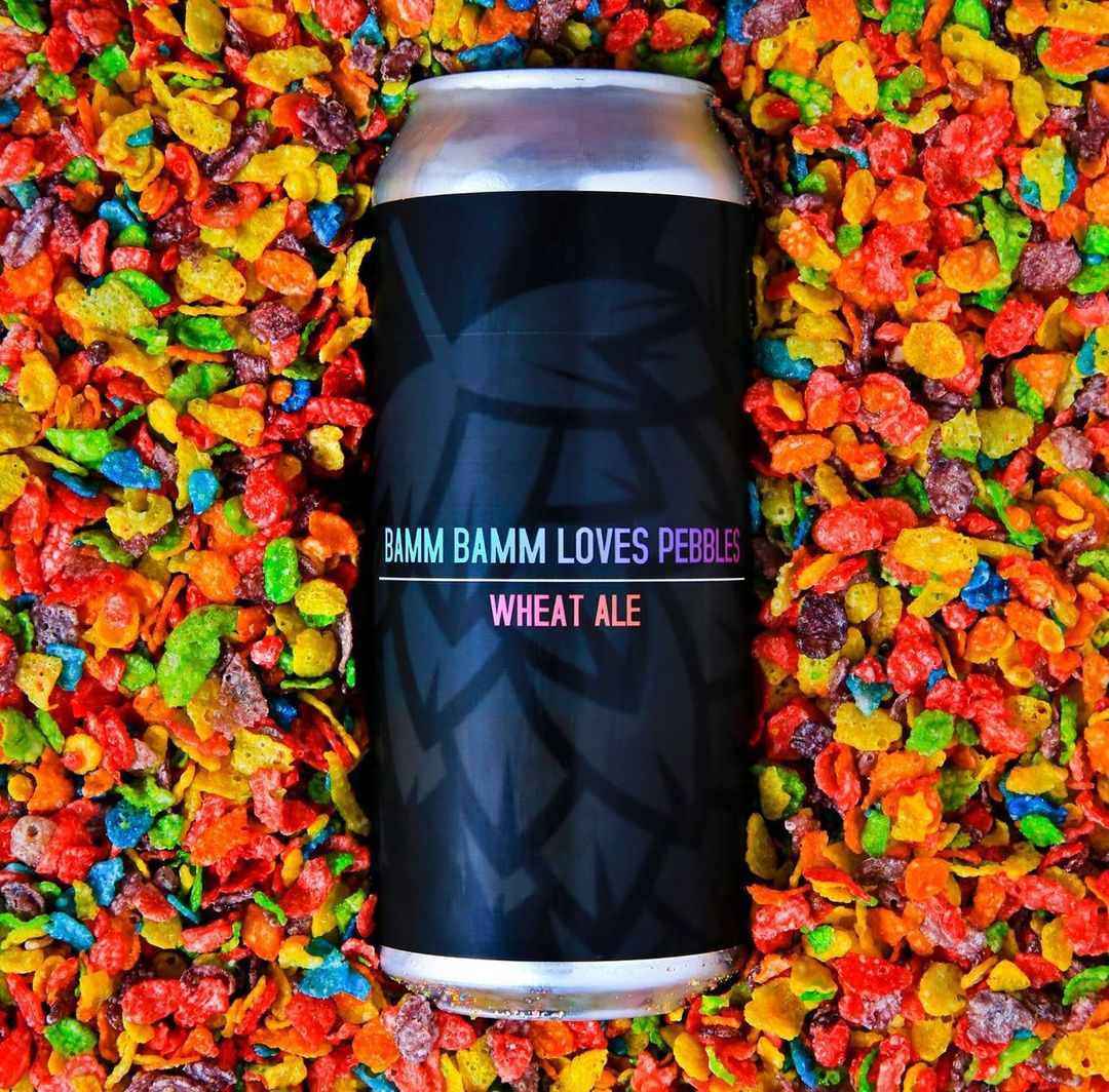 Can of Bamm Bamm Loves Pebbles, surrounded by fruit flavored cereal
