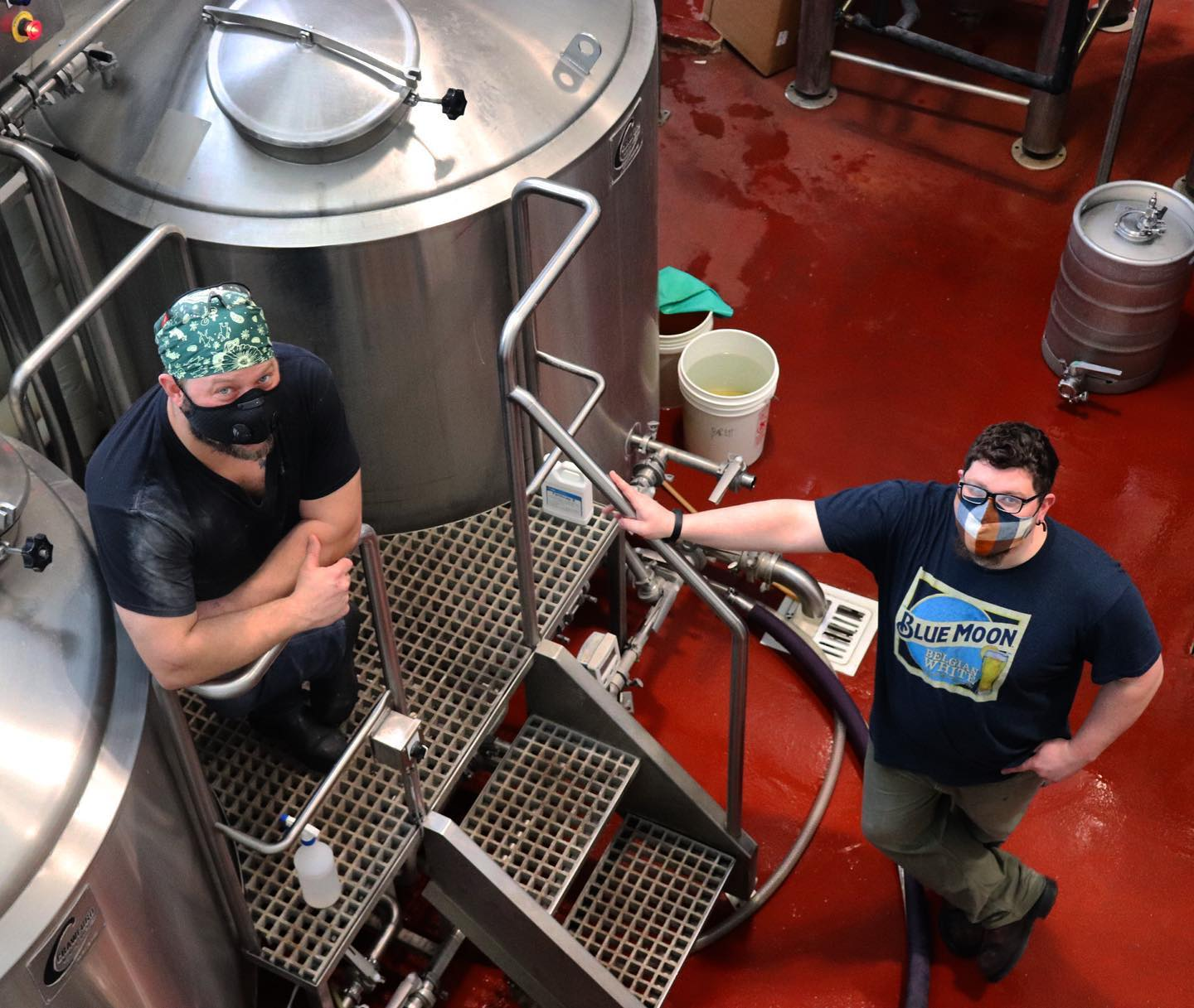 Two Brewers standing near brewing vessels at Pollyanna Brewing Company