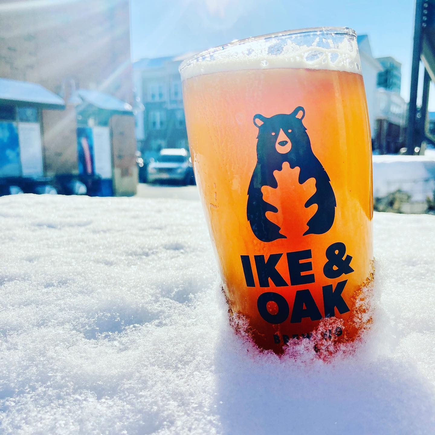 Glass of beer in snow at Ike & Oak Brewing