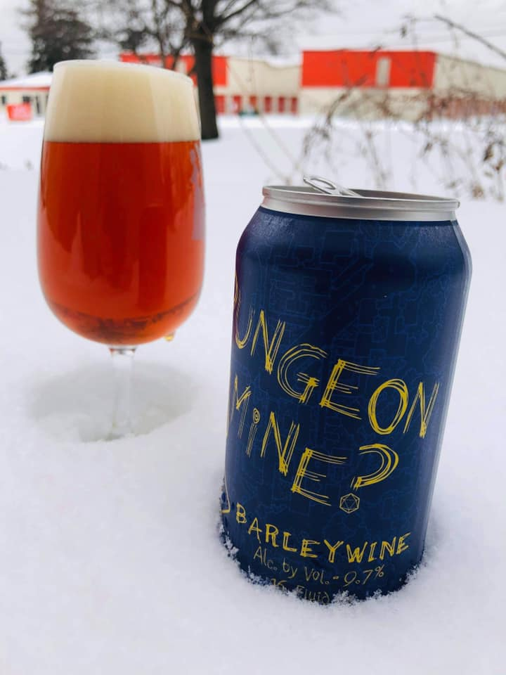 A can and glass of Your Dungeon or Mine Barleywine