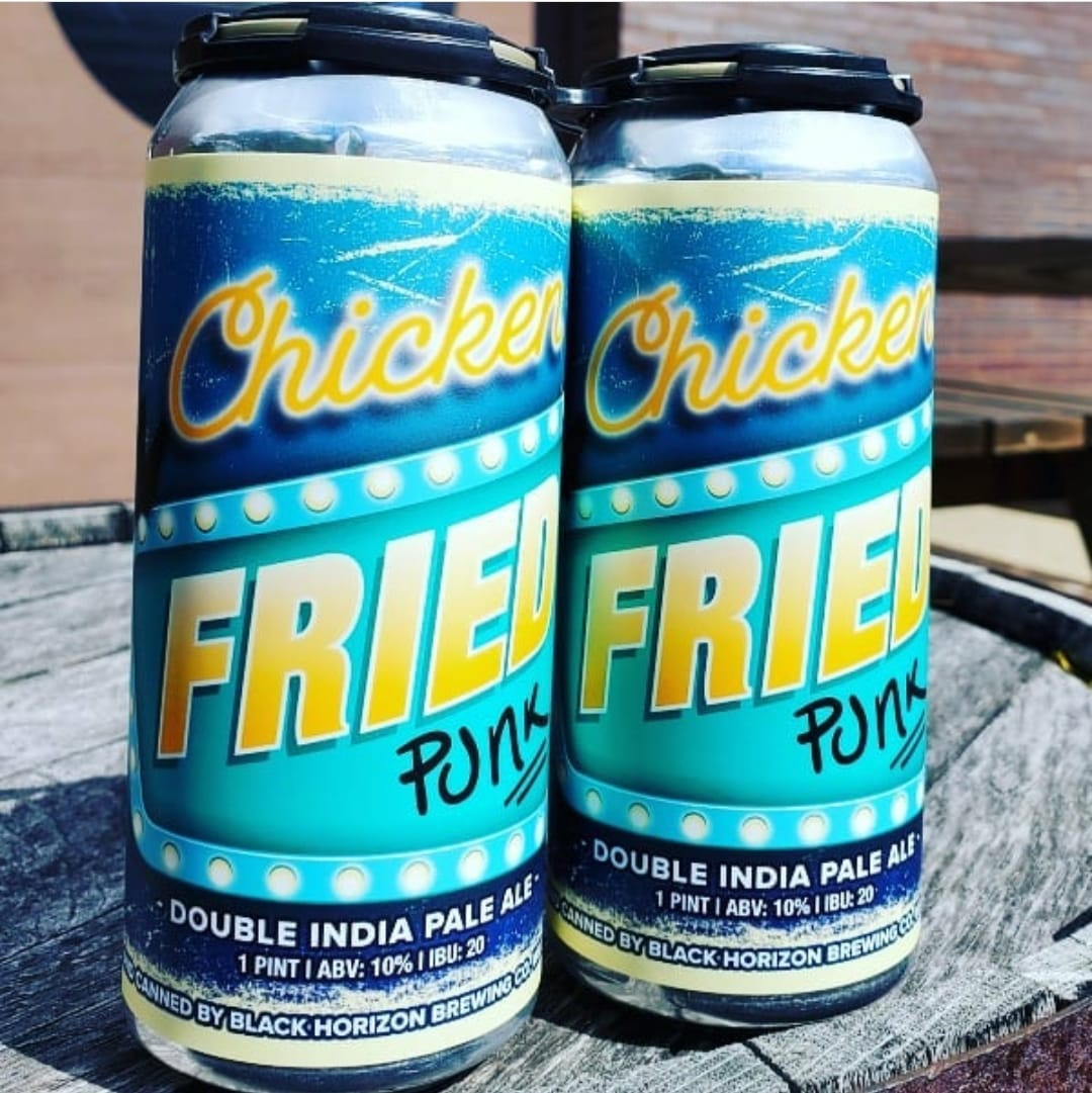 Cans of Chicken Fried Punk on a barrel outside Black Horizon Brewing Company in Willowbrook, IL