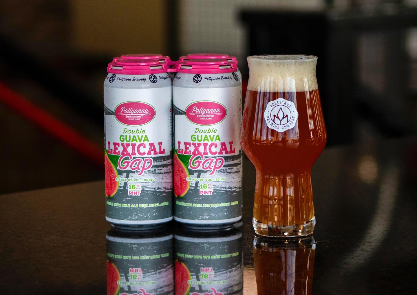 Two cans and a glass of Double Guava Lexical Gap from Pollyanna Brewing Company