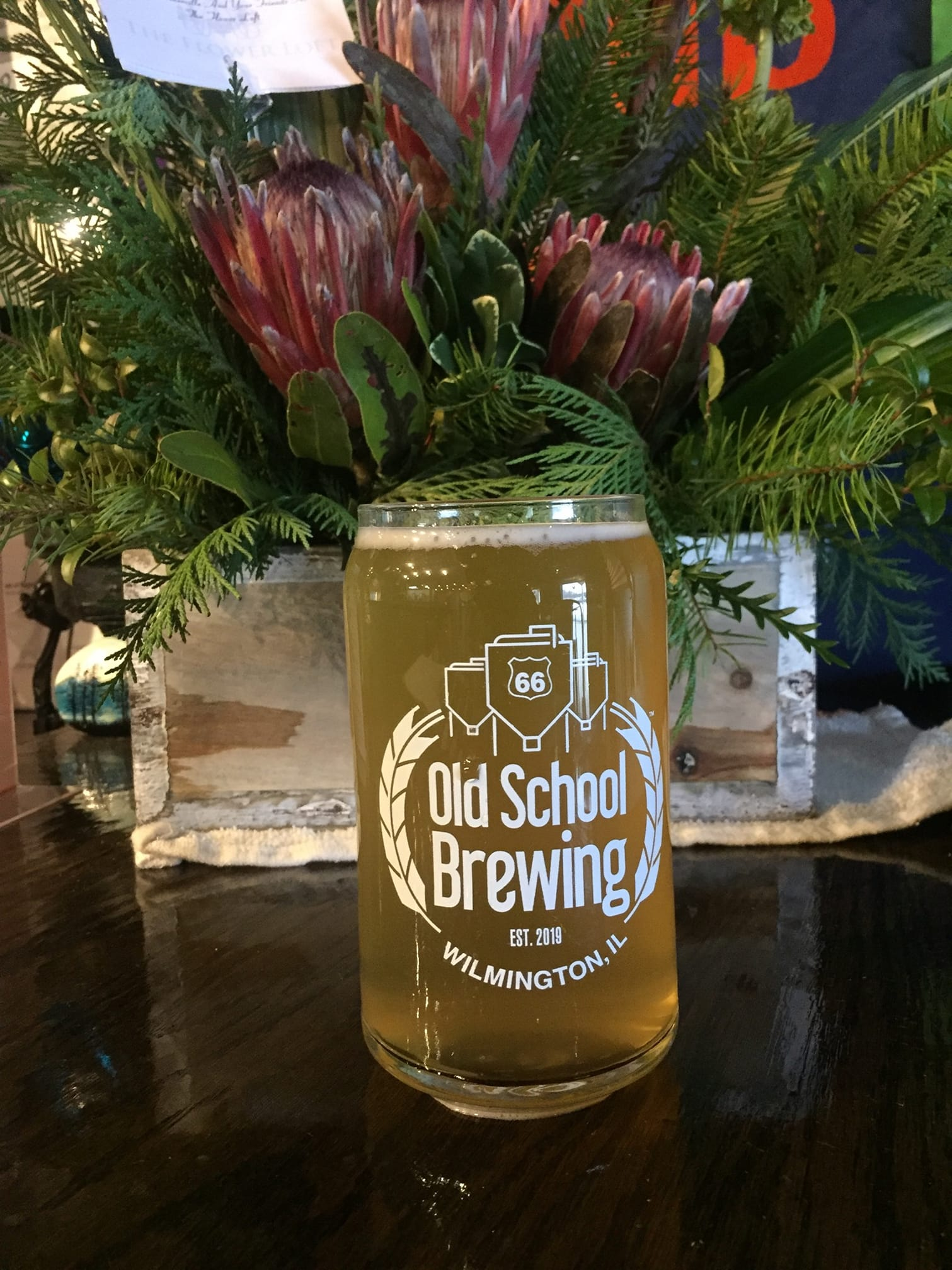Glass of beer in front of seasonal decorations at Rt66 Old School Brewing