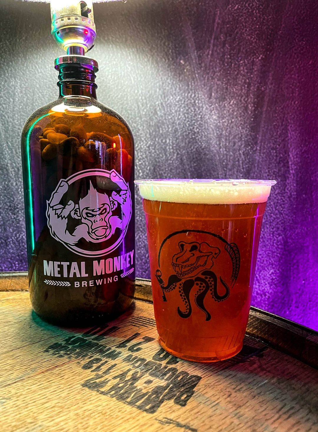 Howler and a glass of beer at Metal Monkey Brewing