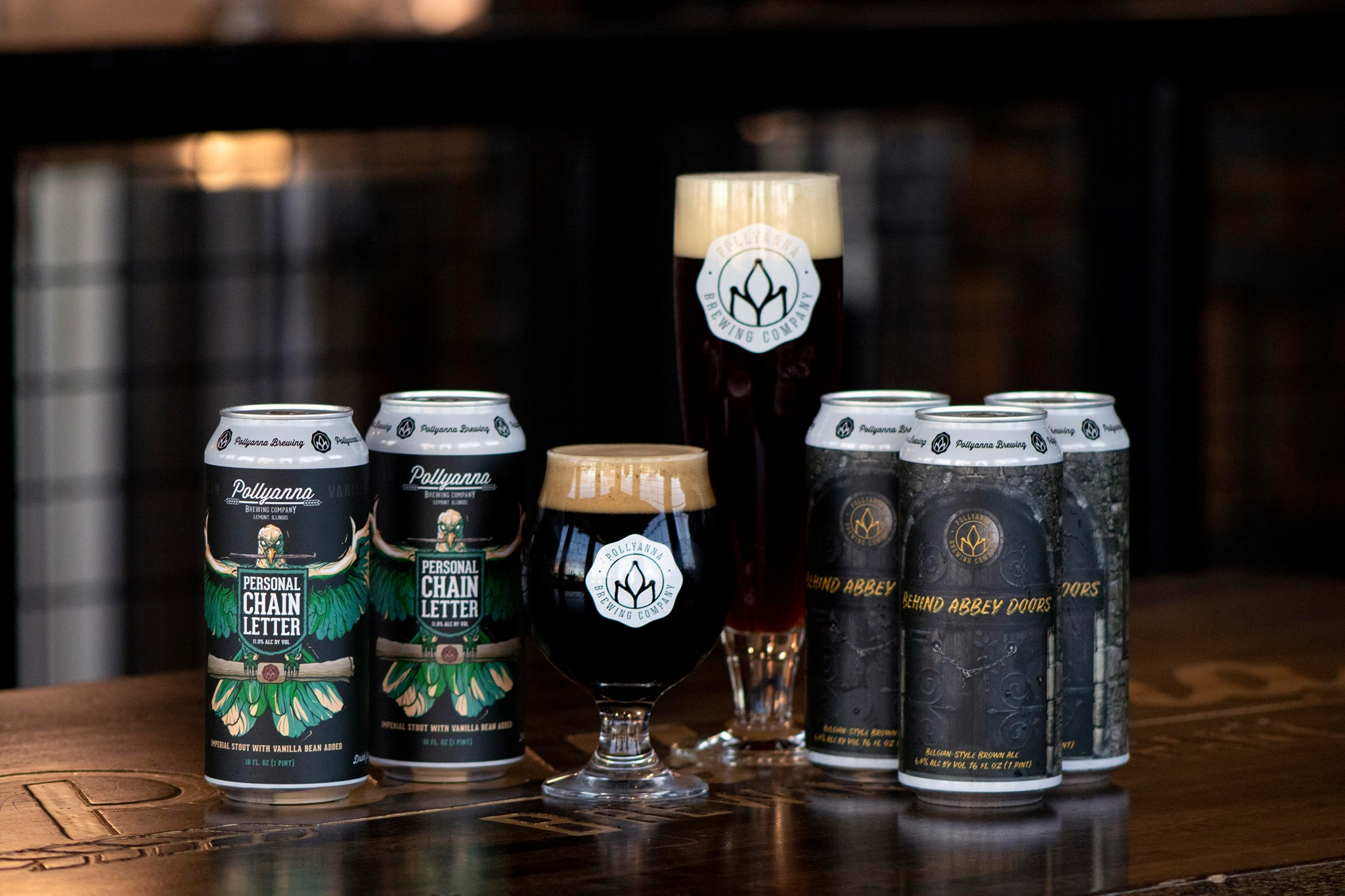 Cans of Personal Chain Letter and Behind Abbey Doors from Pollyanna Brewing Company