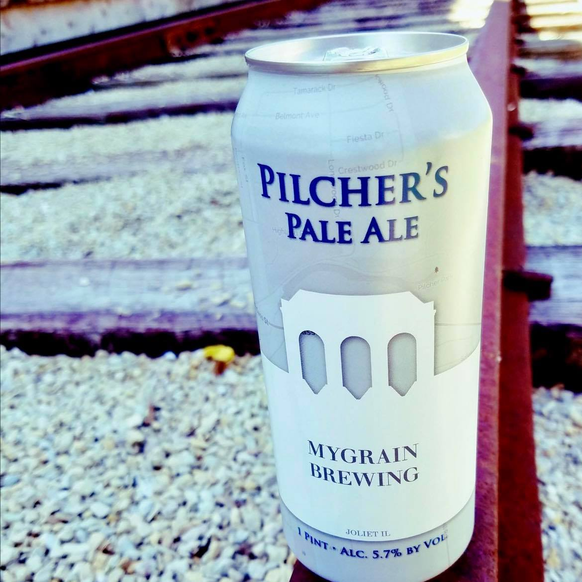 A Can of Pilcher's Pale Ale sitting on the railroad track