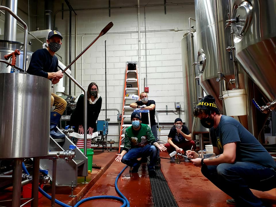 Miskatonic and Skeleton Key Brewers making a batch of beer