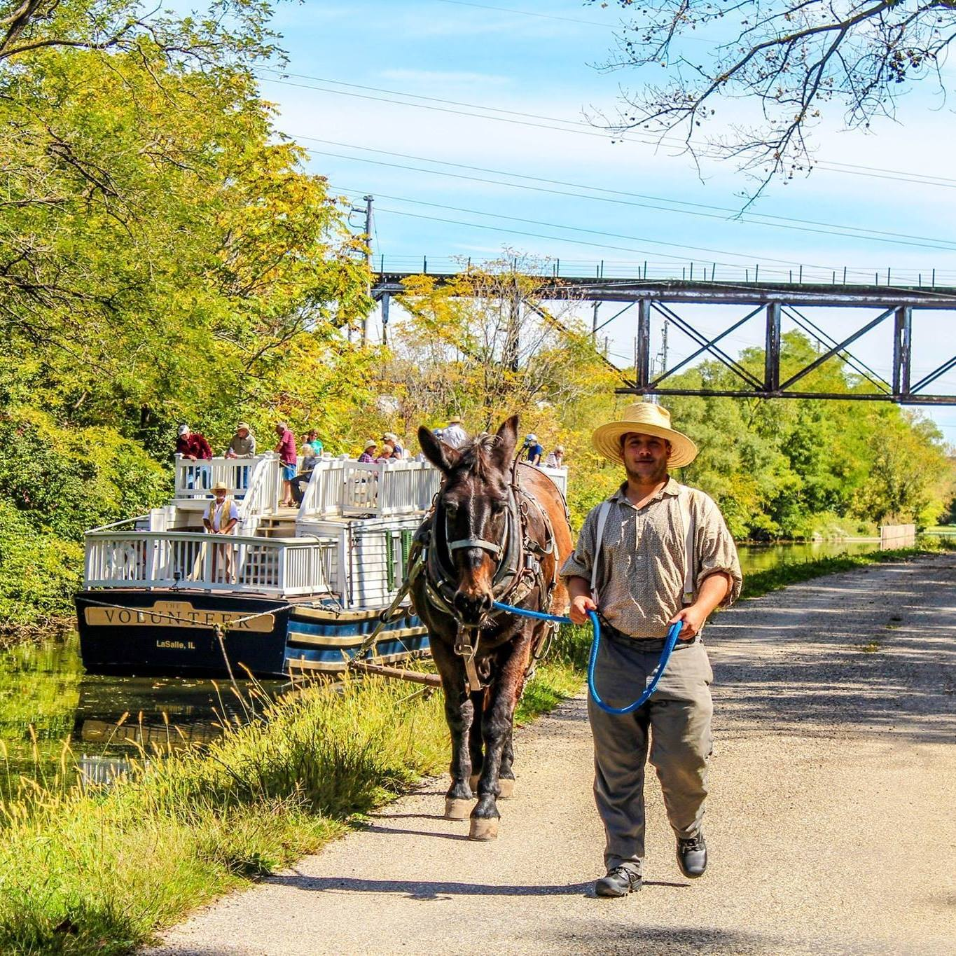 I&M Canal boat and a guy walking a mule long the river