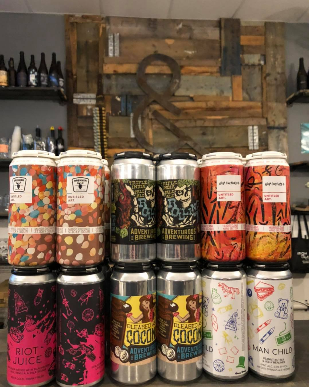 SEveral cans of beer at Iron&Glass Romeoville