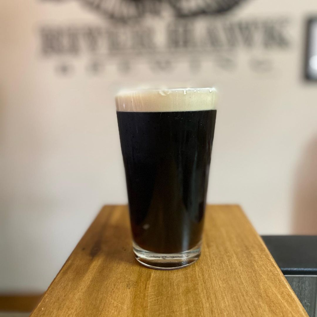 Glass of dark beer on the bar at River Hawk Brewing in Channahon, IL
