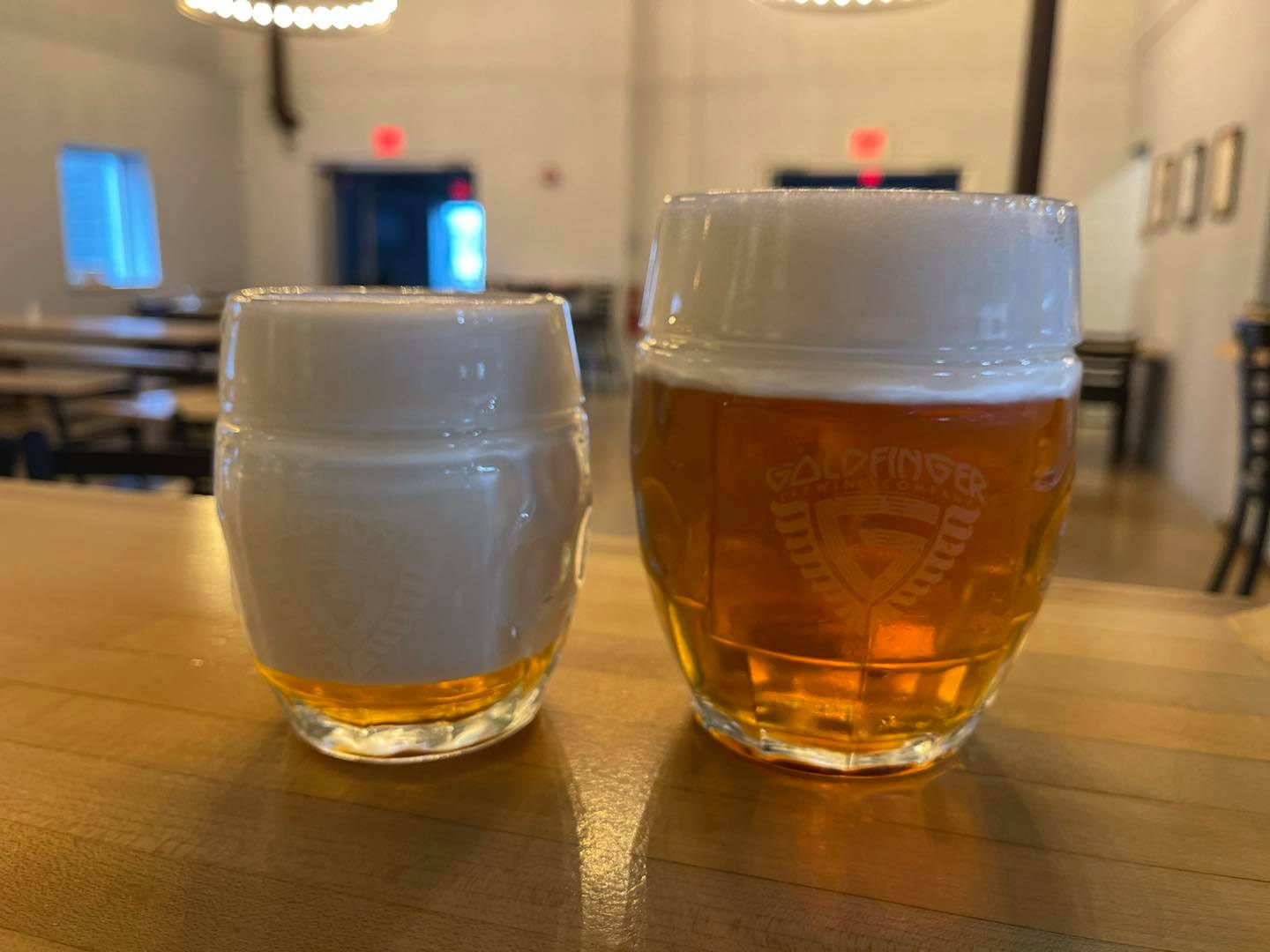 Goldfinger's Bohemian Pilsner in two glasses