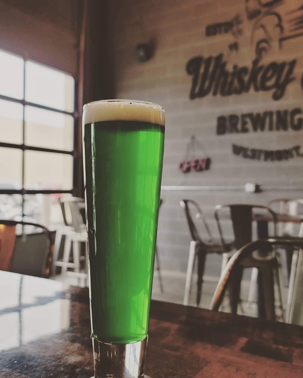 Green Beer in a tall glass at Whiskey Hill