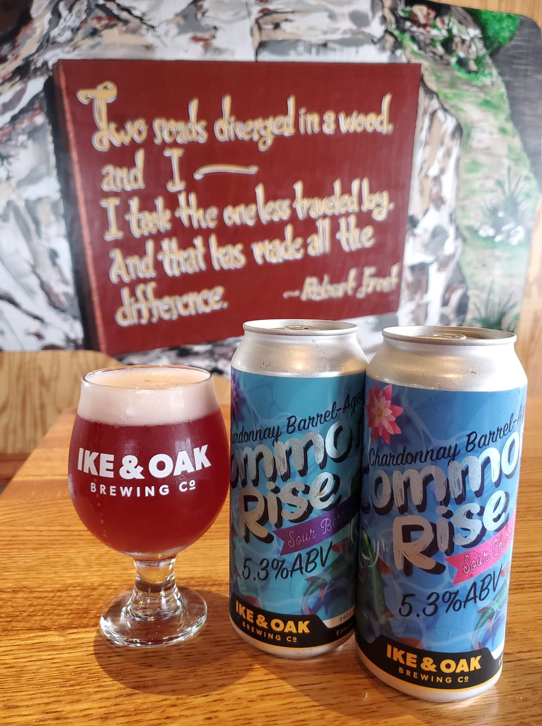 Glass and two cans of Ike & Oak Brewing's Common Rise