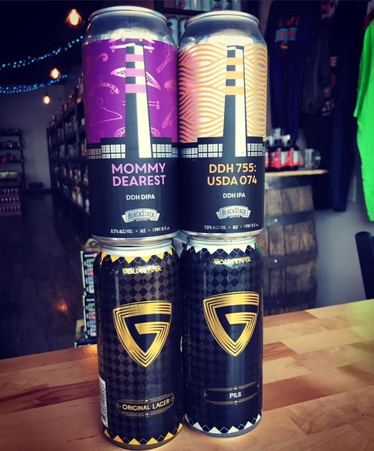 four different cans at Orange and Brew