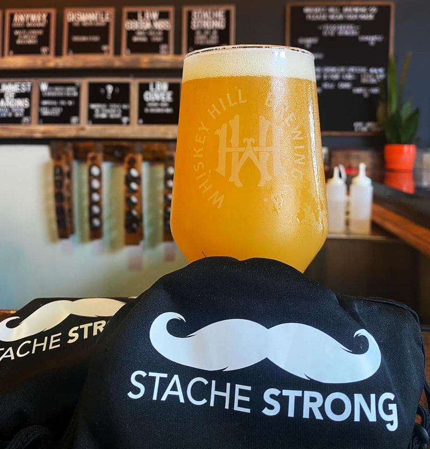 Glass of Stache Strong