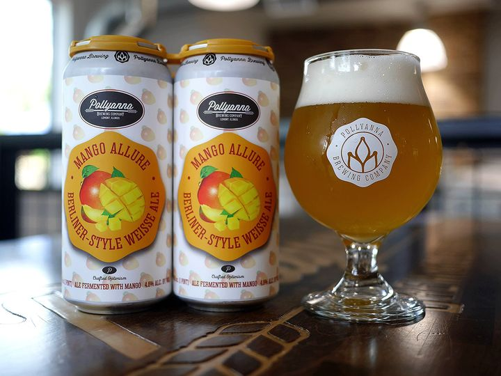 Cans and a glass of Pollyanna's Mango Allure
