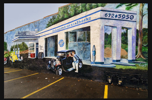 Murals of old gas station in Streator, IL